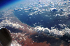 Above the morning Earth, ocean & clouds. Breathtaking aerial view over the beautiful morning Earth Stock Image