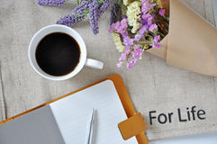 Above of Notebook and Coffee Cup with Wording For Life Stock Image