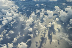 Above The Patchy Clouds. Patchy cloud cover over North Queensland, flying out to sea Stock Photography