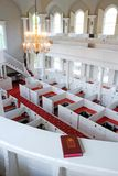Above the pews, from the choir loft stock images