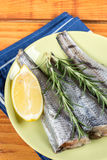 Above plate with hake fish and rosemary and lemon.  Royalty Free Stock Photography