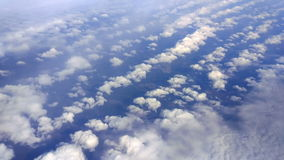 Above Puffy Clouds stock video