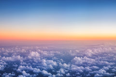 Above The Puffy Clouds on Sunset Stock Photography