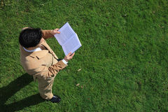 Above - Reading. Above view of a business man reading a book Stock Photography