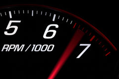 Above red line. Close up on a tachometer reaching maximum engine speed Stock Image