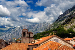 Above red roofs of historic town Kotor with towers St Tryphon's Cathedral, Montenegro Royalty Free Stock Photography