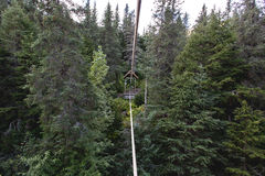 Above River Rope Cage. Deep in an Alaskan forest this self propelled cage was the only way to traverse a rapid flowing freshwater river Stock Image
