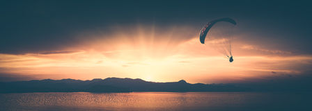 Above the sea against bright colorful sunset. Instagram stylisat Royalty Free Stock Image