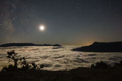 Above a sea of clouds stock image