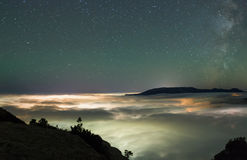 Above a sea of clouds royalty free stock photo