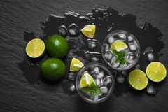From above shot of alcoholic mojitos and fresh mint with limes o Stock Images