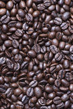 From above shot of coffee beans on table. Vertical close up shot. Royalty Free Stock Images