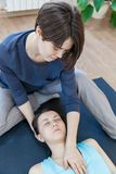 Trainer doing special therapy with physical contact royalty free stock images