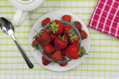 Above shot of a plated glass bowl of ripe strawberrys Stock Photography