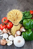 Above Shot of Raw Spaghetti and Ingredients for Sauce Stock Photos