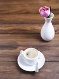 From above shot of white coffee cup and vase with flower Royalty Free Stock Photos
