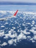 Above the skies. On the board of a plane above the skies and clouds royalty free stock image