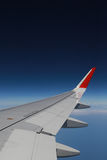 Airplane window. From airplane window look outside the sky Royalty Free Stock Photography