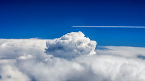 Above the sky. Aerophotography of flying by plane above the cloud that looks like an explosion Stock Photos
