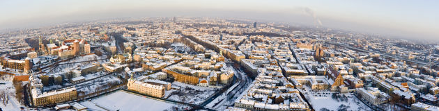 Above Snowed Krakow. Panorama of Krakow (Poland) in winter, view from a balloon Royalty Free Stock Images
