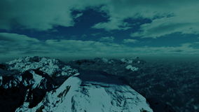 Above Snowy Mountain, Time Lapse Clouds, stock footage. Video stock illustration