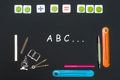 Above stationery supplies and text abc on blackboard royalty free stock images
