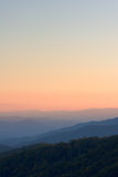Above Sunset Peaks. Simple view high above the peaks of the Smoky Mountains NP showcasing the gentle variations in the peaks and sky Royalty Free Stock Photography