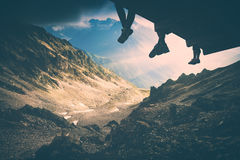 Above Titnuld valley. Instagram stylisation. People sit on a wooden flooring above the mountain valley near the glacier under Mt.Titnuld. Caucasian Mountains Royalty Free Stock Image