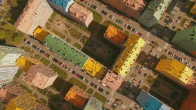 Above top view cozy comfortable colored houses in a European city 4K UHD aerial stock video footage