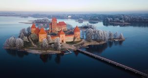 Above Trakai castle at winter, aerial video. Trakai castle at winter, aerial view above the castle stock footage