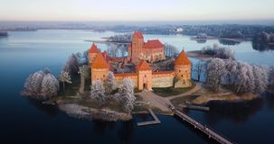 Above Trakai castle at winter, aerial. Trakai castle at winter, aerial view above the castle stock footage