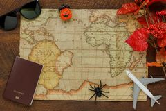 Above view of accessory Happy Halloween with items to travel background. Concept.Mix several object on the modern rustic brown wooden at home office desk stock photos