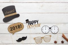 Above view aerial image of DIY photo booth props decorations Happy new year 2018. Home party decor background concept.Table top item on modern rustic white wood Royalty Free Stock Images