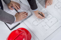 Above view of architects hands revising a house project Royalty Free Stock Images