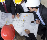 Above view of architects sitting at Stock Photography