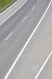 Above view at asphalt road painted by white lines Royalty Free Stock Photo