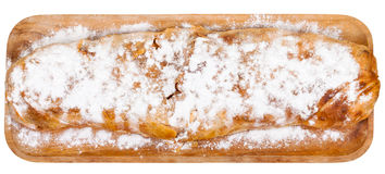 Above view of baked apple strudel on wooden board Stock Image