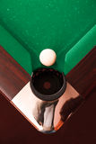 Above view on billiard ball opposite to a pocket. Above view on white billiard ball opposite to a pocket. Angle of the billiard table Royalty Free Stock Image