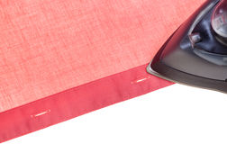 Above view of black iron ironing red shirt Royalty Free Stock Image
