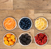 From above view of bowls of multiple fruits Stock Images
