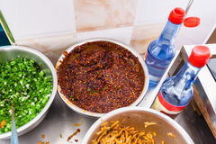 Above view of bowls with spicy toppings on kitchen Stock Photography