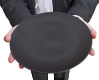 Above view of businessman holds empty black plate Stock Photo
