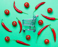 Above view at Chili pepper and shopping cart Stock Images