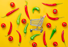 Above view at Chili pepper and shopping cart Stock Photo