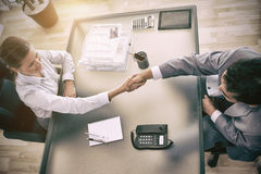 Above view of consultant shaking hands with customer Stock Photo