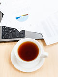 Above view cup of tea and office tools Royalty Free Stock Photos