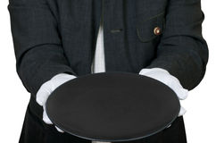 Above view of empty black plate in hands in gloves Royalty Free Stock Images