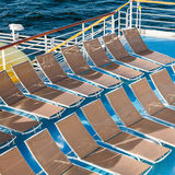 Above view of empty chairs in sunbathing area Stock Images