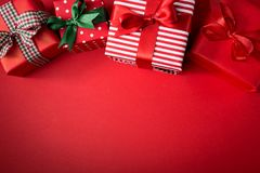 Red Christmas presents on red. From above view of few wrapped beautiful gifts decorated with colorful ribbons and composed on red Royalty Free Stock Images