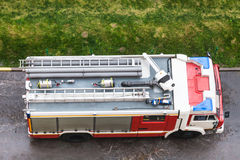 Above view of fire engine on wet road Royalty Free Stock Image
